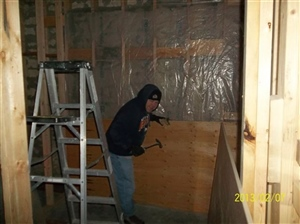 Chuck Downey working on CB wall